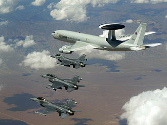 Structure of NATO - NATO E-3A flying with United States Air Force F-16 Fighting Falcons in a NATO exercise.