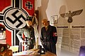 Nazi German Kriegsmarine swastika flag, SS uniform-helmet-armlet, Signal magazine, phone, prisoner uniform, leather coat, wall eagle Adler, Bekanntmachung-Kunngjøring, etc. Gestapo office Lofoten Krigsminnemuseum Norway 2019-05-08 DSC0.jpg