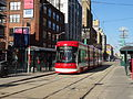 New streetcar 4404 heading south on Spadina, near King, 2014 12 20 (6) (15886538279).jpg