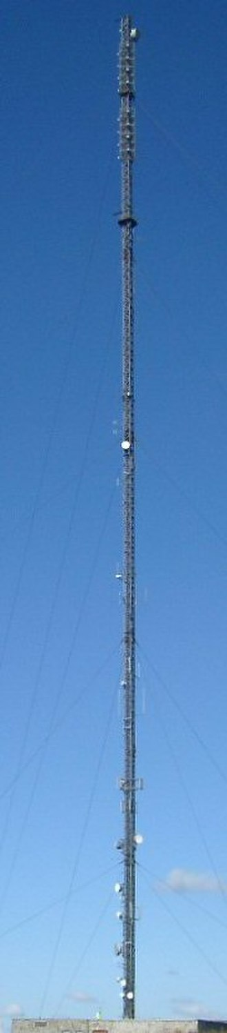 North Hessary Tor transmitting station - Mast with worker at base
