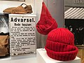 """Norway's WW2 Resistance Museum, Oslo (Hjemmefrontmuseet). The Austerity of Occupation - red woolen caps outlawed 1942-02-26 as symbols of national unity (""""røde toppluer"""", from exhibition). Photo 2017-11-30.jpg"""