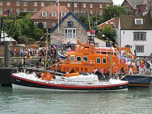 Salcombe Lifeboat Station - Orinos, the former Salcombe Lifeboat Samuel and Marie Parkhouse, alongside a modern Severn class lifeboat.