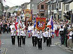 The Blair Memorial Band parade in Omagh on 12th July 2008, with Orangemen in the background.