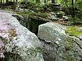 Pachaug Trail - split rock passage near Green Fall Pond trail head, Voluntown, CT.jpg