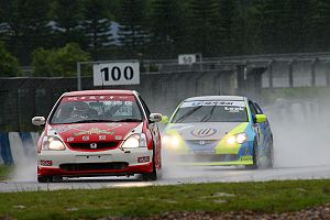 Zhuhai International Circuit - Paul Poon leads Kenneth Look in the rain at ZIC during a Hong Kong Touring Car Championship race.