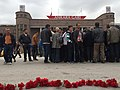 People lay flowers for victims of the Ankara bombing outside Ankara station, October 11, 2015.jpg