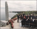 Photograph of President Reagan giving a speech on the 40th Anniversary of D-Day at Pointe du Hoc, Normandy, France - NARA - 198549.tif