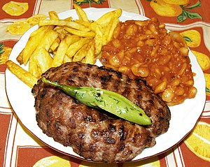 "Side dish - Pljeskavica with ""sides"" of French fries and baked beans"