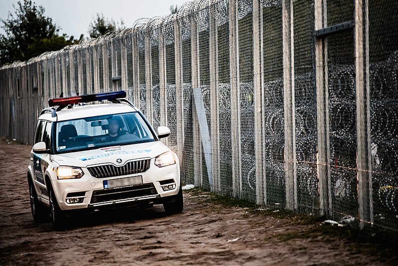 File:Police car at Hungary-Serbia border barrier.jpg