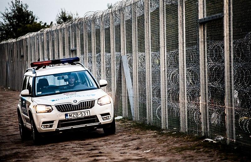 File:Police car at Hungary-Serbia border barrier.jpg