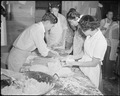 Poston, Arizona. New Year's Fair. Kitchen crew making pies, which were sold to appreciative custom . . . - NARA - 536663.tif