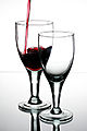 Pouring red wine into a glass.jpg