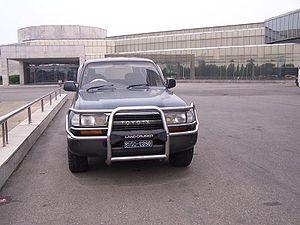 Transport in North Korea - Right hand drive (RHD) Toyota Landcruiser in front of a Pyongyang hotel