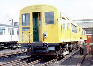 London Underground Q38 Stock - Q38 stock in yellow works livery at Acton Works open day, 1983.