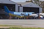 Regional Express Saab 340B (VH-ZJS) in former Happy Air Travellers livery at the REX maintenance hangar at Wagga Wagga Airport.jpg
