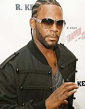 A photograph of R. Kelly.