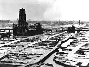 German bombing of Rotterdam - Rotterdam's city centre after the bombing. The heavily damaged (now restored) St. Lawrence church stands out as the only remaining building reminiscent of Rotterdam's medieval architecture.