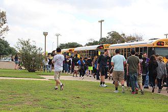 Round Rock Independent School District - Round Rock ISD school bus parked in front of school