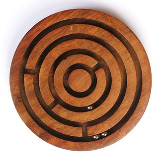 Ball-in-a-maze puzzle - A simple wooden ball-in-a-maze
