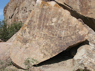 Dzungar people - Clear script on rocks near Almaty