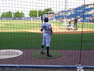 On-deck - A player waits to bat in the on-deck circle
