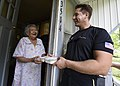 Sailor delivers Meals-on-Wheels to elderly and homebound residents. (35855356622).jpg