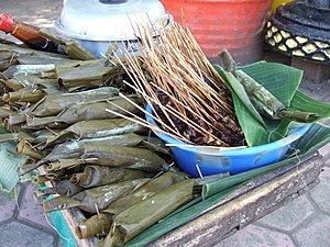 Lontong - Wrapped lontongs with satay selling in Java, Indonesia