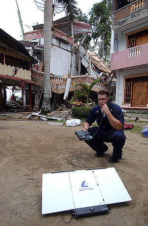Inmarsat - Inmarsat satellite telephone in use after a natural disaster in Nias, Indonesia.  The unit depicted was manufactured by Thrane & Thrane A/S of Denmark. (April 2005)