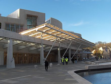 The public entrance of the Scottish Parliament building, opened in October 2004. ScottishParliamentFront.JPG