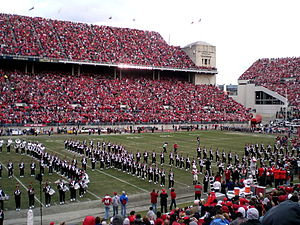 "Jack Nicklaus - Nicklaus ""dotting the i"" at the Ohio State Buckeyes football game against Minnesota Golden Gophers at Ohio Stadium on 2006-10-28. Nicklaus can be seen in red in the middle of the field."