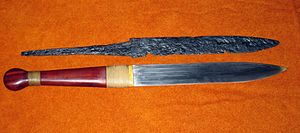Seax - The remains of a seax together with a reconstructed replica