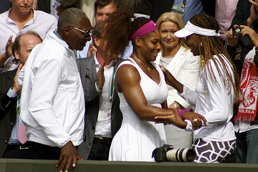Serena Williams embraces Venus Williams as Father looks on