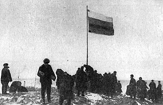 October Revolution Island - Raising of the Russian flag at Cape Berg during the 1913 Arctic Ocean Hydrographic Expedition.