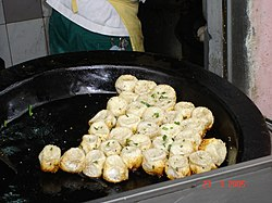 Sheng Jian Bao on a pan.jpg
