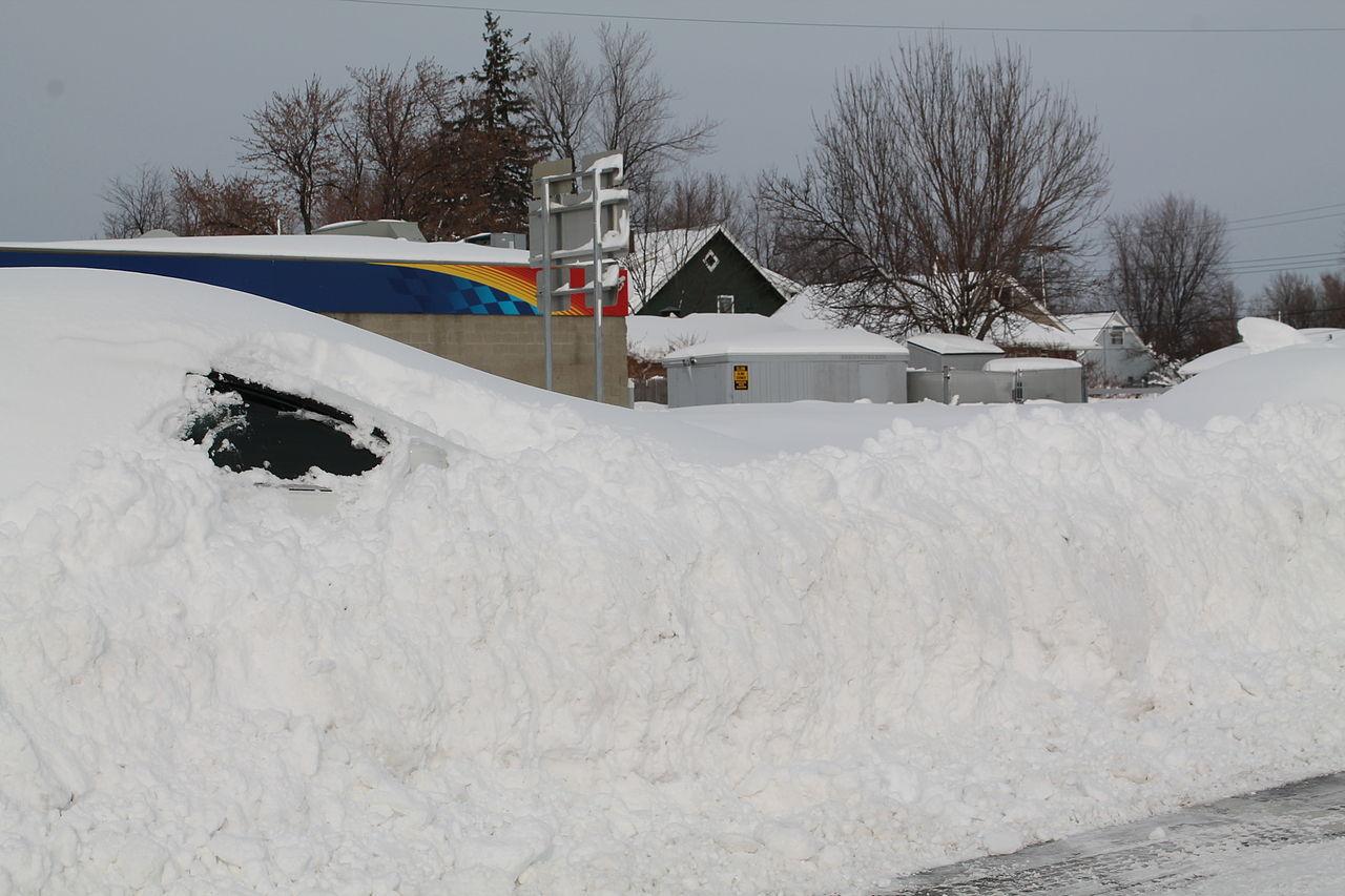 1280px-Snow_buried_car.JPG