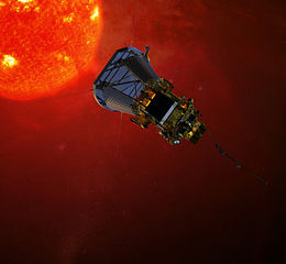 Digital model of a spacecraft with a hexagonal bus and large heat shield oriented to the surface of the sun