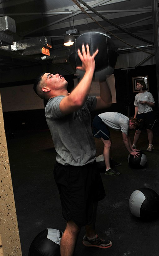 Soldier tosses a medicine ball while working out DVIDS462753