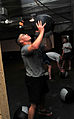 Soldier tosses a medicine ball while working out DVIDS462753.jpg