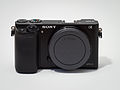 Sony Alpha ILCE-6000 APS-C-frame camera with body cap.jpeg
