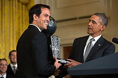 bca896917 Spoelstra presents President Barack Obama a team trophy in January 2014.