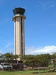 Starr-060820-8611-Delonix regia-habit and view ATC tower-Kahului Airport-Maui (24770906921).jpg