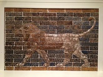 Striding Lion - Glazed brick relief of a striding lion from the palace of Nebuchadnezzar II on display in the Royal Ontario Museum