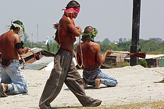 Self-flagellation is ritually performed in the Philippines during Holy Week (on Good Friday, before Easter). Striding flagellant.jpg