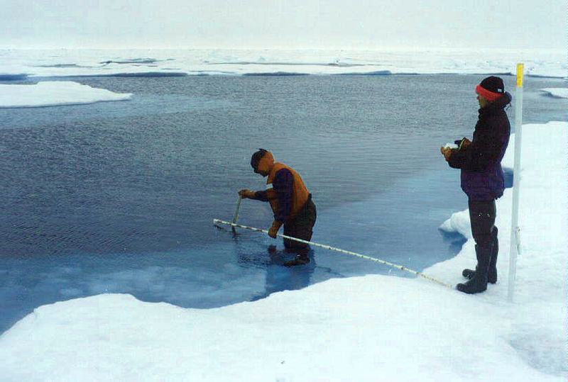 SHEBA (Surface Heat Budget of the Arctic Ocean) researchers taking data in a melted area of the Arctic Ocean ice pack. (Source: U.S. Army Cold Regions Research and Engineering Laboratory: http://www.crrel.usace.army.mil/sid/personnel/perovichweb/photogallery/photo00008999/real.htm - Donald K. Perovich)
