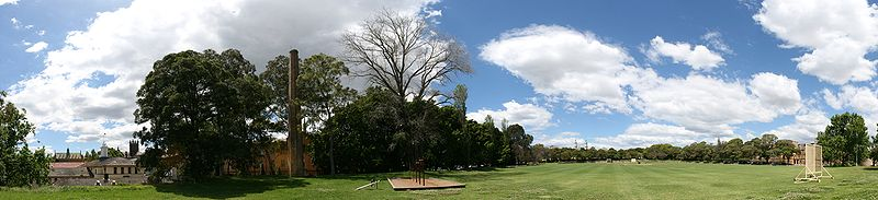 St Paul's Oval—a large, green, tree-lined field under a blue sky with clouds