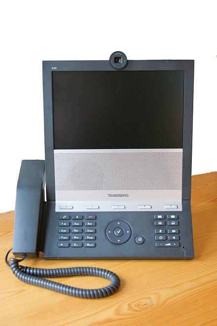 "The Tandberg E20 is an example of a SIP-only device. Such devices need to route calls through a Video Communication Server to be able to reach H.323 systems, a process known as ""interworking"" (2009). TANDBERG E20.jpg"