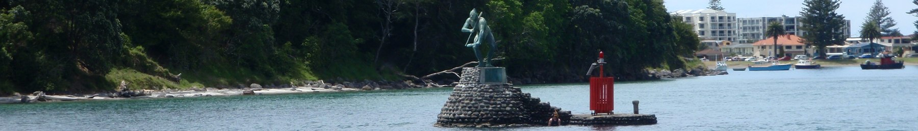 Tauranga banner Harbour entrance with statue.JPG