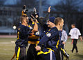 Teammates congratulate U.S. Navy Cmdr. Brent Gaut, left, a student at the U.S. Naval War College (NWC), after he made an interception during an Army-Navy flag football game at Nimitz Field at Naval Station 131206-N-PX557-370.jpg