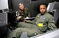 Terrence Howard studying aircraft controls for his role in the 2008 Iron Man film.jpg