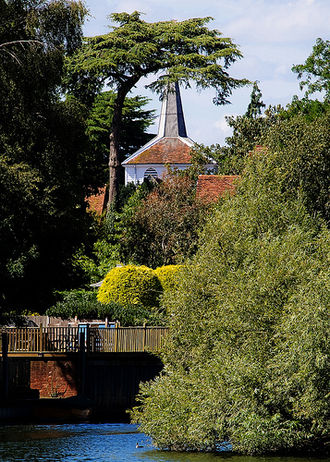 Thames Ditton - St Nicholas's church and riverside terrace and trees from across the Thames